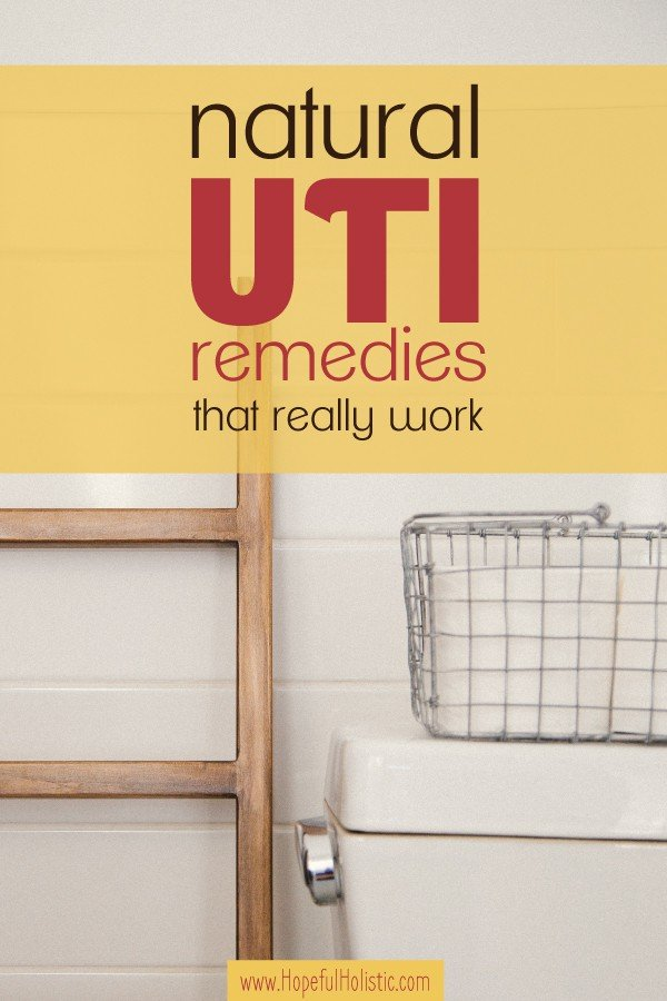 Toilet in a white bathroom with text overlay- natural UTI remedies that really work