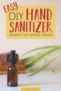 2oz spray bottle of homemade hand sanitizer with text overlay- easy diy hand sanitizer- alcohol free and all-natural