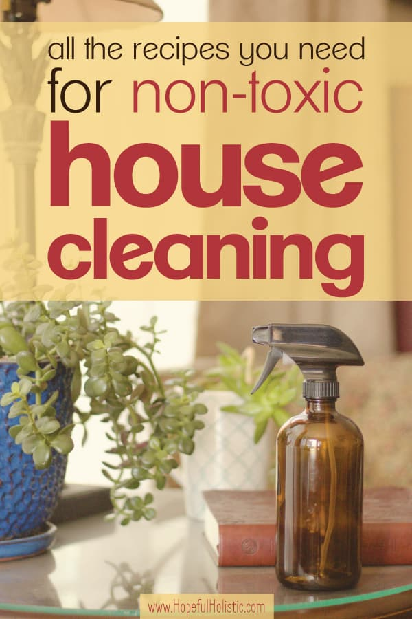 Amber spray bottle on table with plants and text overlay- all the recipes you need for non-toxic house cleaning