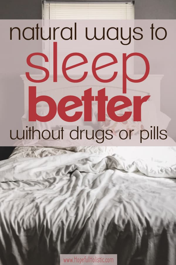 Picture of a bed with white comforter and pillows and a white headboard and text overlay- natural ways to sleep better without drugs or pills