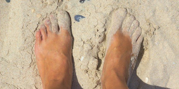 Image of feet in sand at the beach