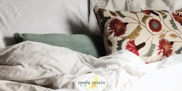 White sheets and floral pillow