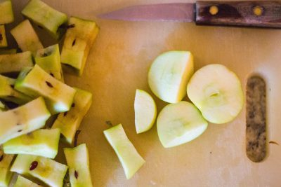 Cut apples for homemade applesauce