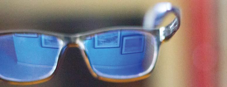 Glasses with blue light reflected in them