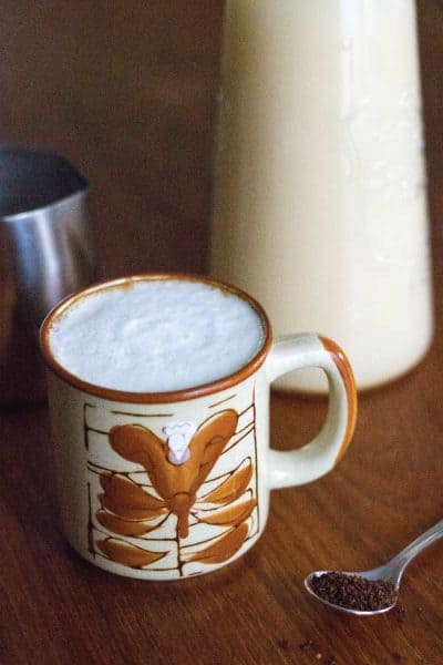 Healthy root coffee in a mug with homemade almond milk