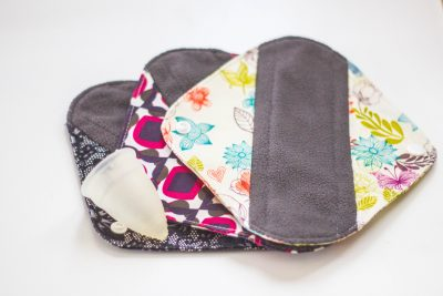 A menstrual Diva cup and reusable cloth pads