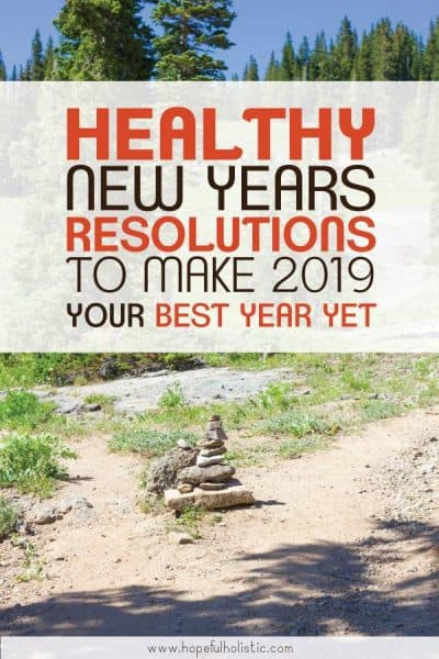 Pathway with a cairn in a forest with text overlay- healthy new years resolutions to make 2019 your best year yet