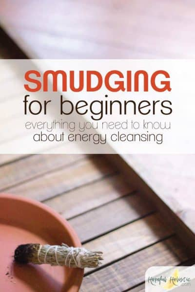 Smoking smudge stick with text overlay- smudging for beginners, everything you need to know about energy cleansing