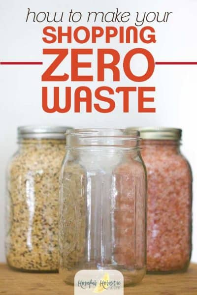 Glass mason jars with food from bulk shopping with text overlay- how to make your shopping zero waste