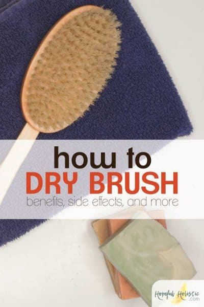 Boar brush for dry brushing on a towel with text overlay- how to dry brush, benefits, side effects, and more