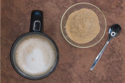 Maca powder next to a maca latte