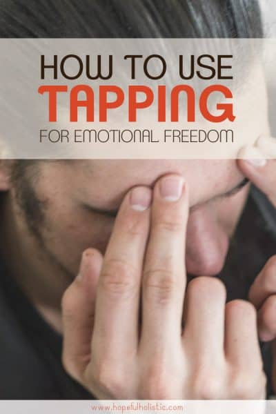 Man tapping on the eyebrow point with text overlay- how to use tapping for emotional freedom