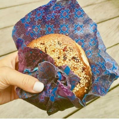 A bagel wrapped in beeswax wrap ceran wrap substitute