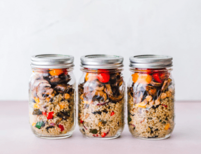 Three glass mason jars with prepped meals