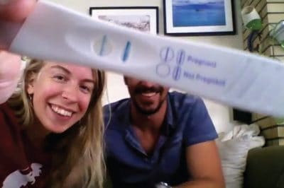 man and woman with pregnancy test
