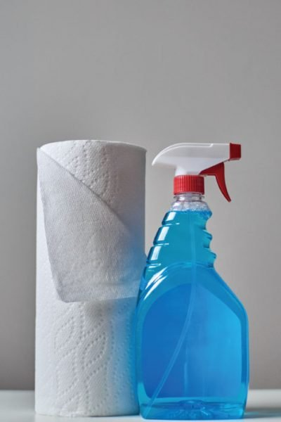 Blue spray bottle and paper towels